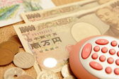 Japanese yen (ten thousand money ) with calculator — Stock Photo