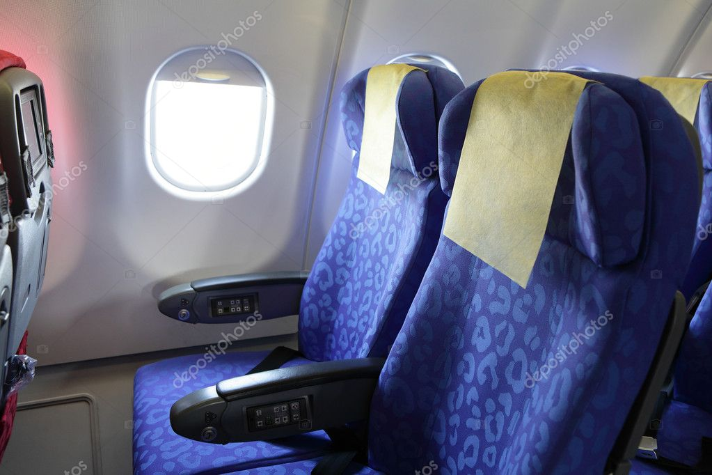 Airplane Blue Seat And Window Inside An Aircraft Stock