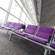 Row of purple chair at airport in Hong kong - Stock Photo