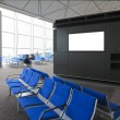 Blank billboard and blue chair in international airport - Stock Photo