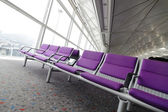 Row of purple chair at airport in Hong kong — Stock Photo