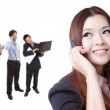 Business woman speaking phone with group — Stock Photo #9165135