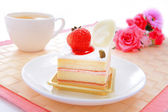 Sweet cake with strawberry at tea time — Stock Photo