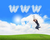 Girl jump and showing tablet pc with www cloud — Stock Photo