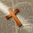 Stock Photo: Wooden cross on old bible