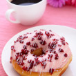 Stock Photo: Sweet cranberry donut with cup of coffee