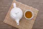 Healthful green tea and teapot — Stock Photo