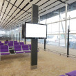 LCD TV and row of purple chair at airport — Stock Photo