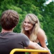 Young happy man and woman in love are looking and smiling at each other in — Stock Photo #8531960
