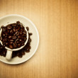 Stock Photo: Cup of Coffee Beans on wood table