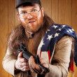 Southern Hick with a rifle and flowing hair flag - Stock Photo