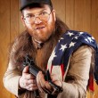 Southern Hick with a rifle and flowing hair flag — Stock Photo