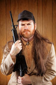 Southern Hick with a rifle and flowing hair — Stock Photo