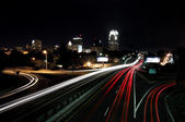 Downtown Skyline and Passing Cars — Stock Photo