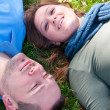 Happy Couple Laying in the Grass — Stock Photo #9538634