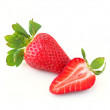 Two sweet and juicy strawberries, whole and sliced piece isolate — Stok fotoğraf
