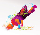 El niño bailando con manchas coloridas y las salpicaduras sobre una luz detrás — Vector de stock