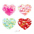 Four different hearts with drops, spots and sprays from a brush. — Image vectorielle