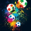 The colorful footballs on a black background — Stok Vektör