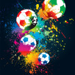 The colorful footballs on a black background — Imagen vectorial
