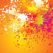 Colorful spots and sprays on orange background — Stock Vector
