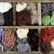 Many autumn colored yarns in wooden box — Stock Photo