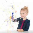 Little girl painting on window — Stock Photo