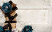 Wrapped vintage packages with flowers — Stock Photo