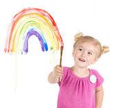 Niña pinturas arco iris en la ventana — Foto de Stock