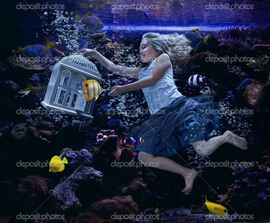 Fish in tank swimming - A Girl Swimming In A Fish Tank Holding A Birdcage With A Fish Swimming Out And Fish Swimming Around Her Photo By Sjhuls