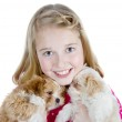 Smiling girl hugging puppies — Stock Photo #8773920