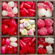 An assortment of red and white valentine candy — Stock Photo