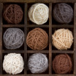 Stock Photo: Assorted balls of yarn in a box
