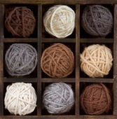 Assorted balls of yarn in a box — Stock Photo