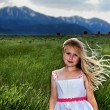 A blond girl with wind blowing through her hair — Stock Photo #9007588