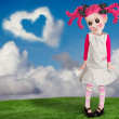 A little girl that looks like a doll — Stock Photo