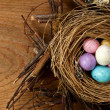 Easter candy in a nest — Stock Photo