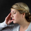 A woman with a headache — Stock Photo #9198657