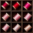 Vintage pink and red spools of thread - Stock Photo