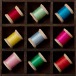 Vintage spools of thread in many colors — Stock Photo