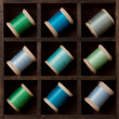 Vintage spools of thread in blues and greens — Stock Photo