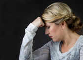 A woman thinking or with a headache — Stock Photo
