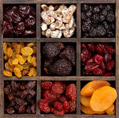 Assorted dried fruit in a printers box — Stock Photo