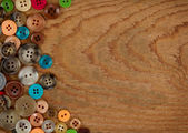 Buttons on a wooden background — Stock Photo