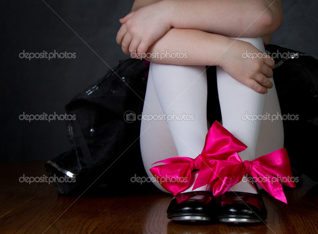 Tap shoes on a little girls feet, dark background room for copy space — Stock Photo #9198697