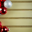 Assorted Christmas Ornaments on green background — Stock Photo