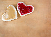 Peanut butter and jelly sandwitch cut in heart shape — Stock Photo