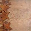 Rusty stars on a wooden background — Stock Photo #9410431