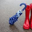 Red rain boots and umbrella — Stock Photo #9410509