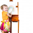 Stock Photo: Little girl painting rainbow